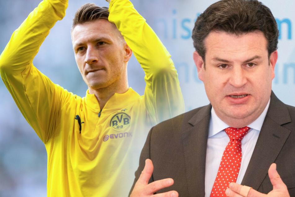 Bundesarbeitsminister Hubertus Heil (r) ist gegen eine Maskenpflicht in der Bundesliga.