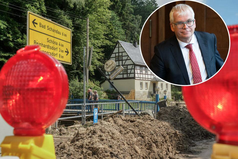 Finanzminister Hartmut Vorjohann (58, CDU, r.) hat per Erlass verfügt, dass vom Hochwasser Betroffene Steuererleichterungen bekommen.
