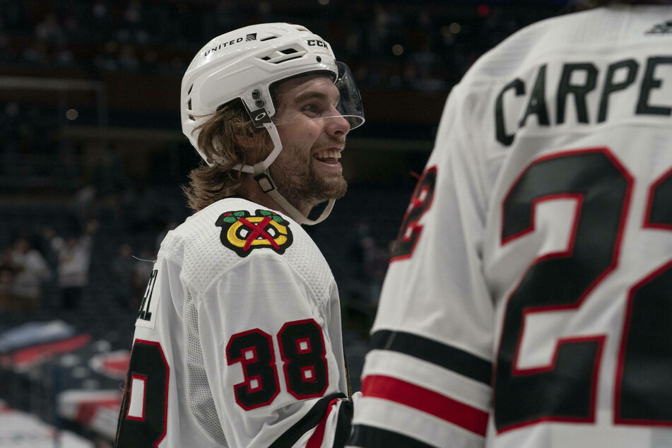 Brandon Hagel scored a goal and two assists as the Blackhawks beat the Predators in overtime 5-4