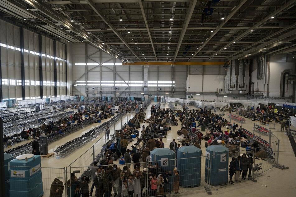 Afghan evacuees wait for transport to US at German air base