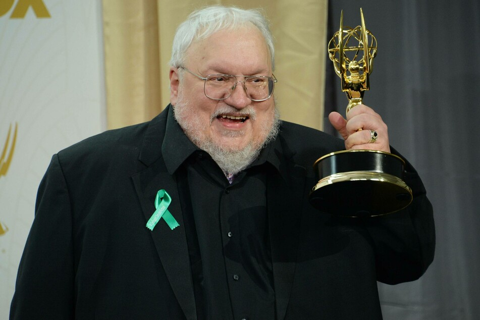 George R. R. Martin raises his 2015 Emmy Award for Outstanding Drama Series for the popular show Game of Thrones (archive image).