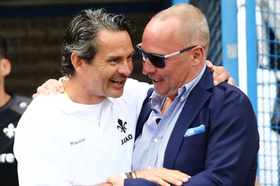 Da hatten sie sich noch lieb: Dirk Schuster (53), im Mai 2018 Darmstadt-Coach, und Aue-Boss Helge Leonhardt (62). Mittlerweile haben sich die Wege wieder getrennt.