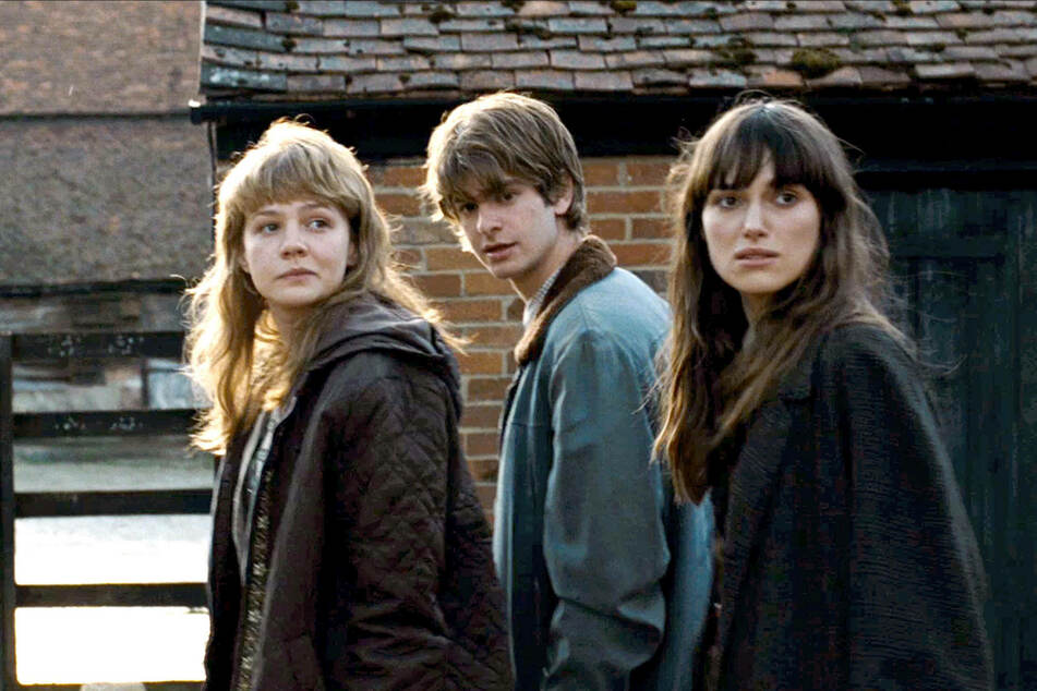 Never Let Me Go was adapted into a 2010 film starring, from left to right, Carey Mulligan as Kathy, Andrew Garfield as Tommy, and Keira Knightley as Ruth (archive image).