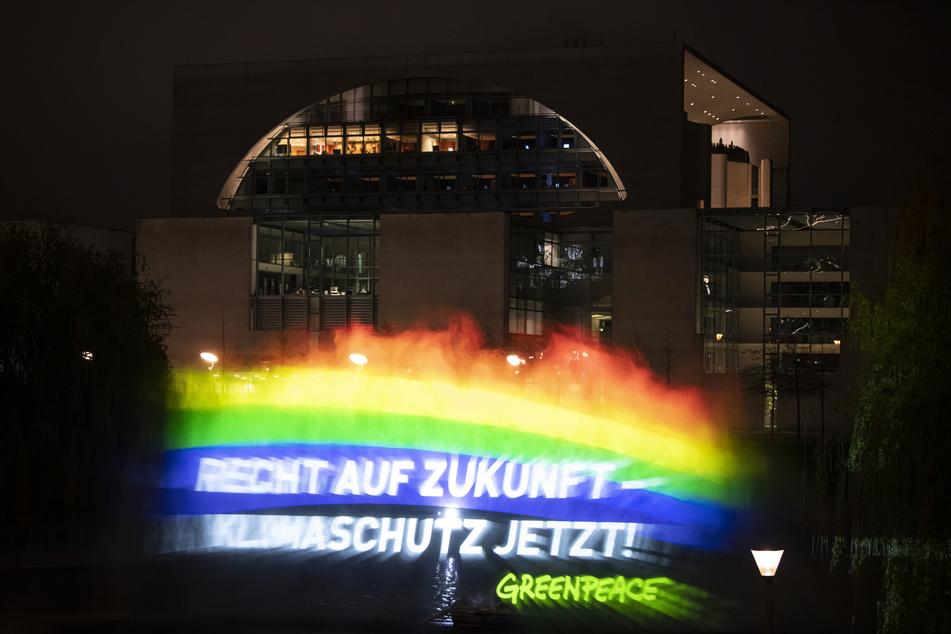 Mit dieser Aktion wollen Greenpeace-Aktivisten ein Zeichen für den Klimaschutz setzen.