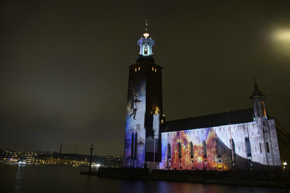 In honor of the Nobel Prize week, light tributes are displayed on some of Stockholm's famous buildings.