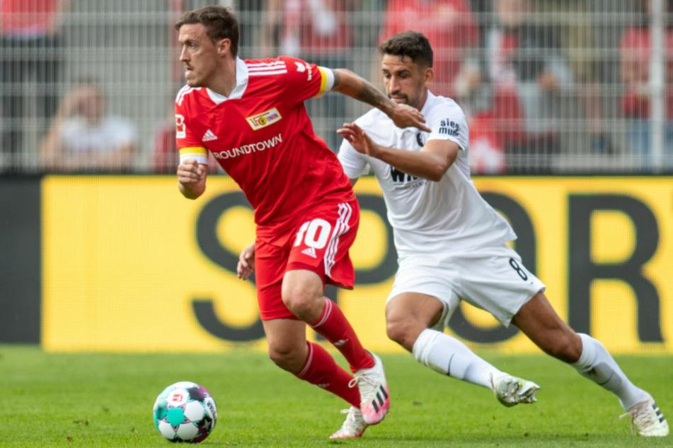 Max Kruse (32, l.) im Zweikampf mit Rani Khedira (26) vom FC Augsburg. Auf dem Platz ist der Neu-Unioner ein Leader, der mit Leistung überzeugen will.