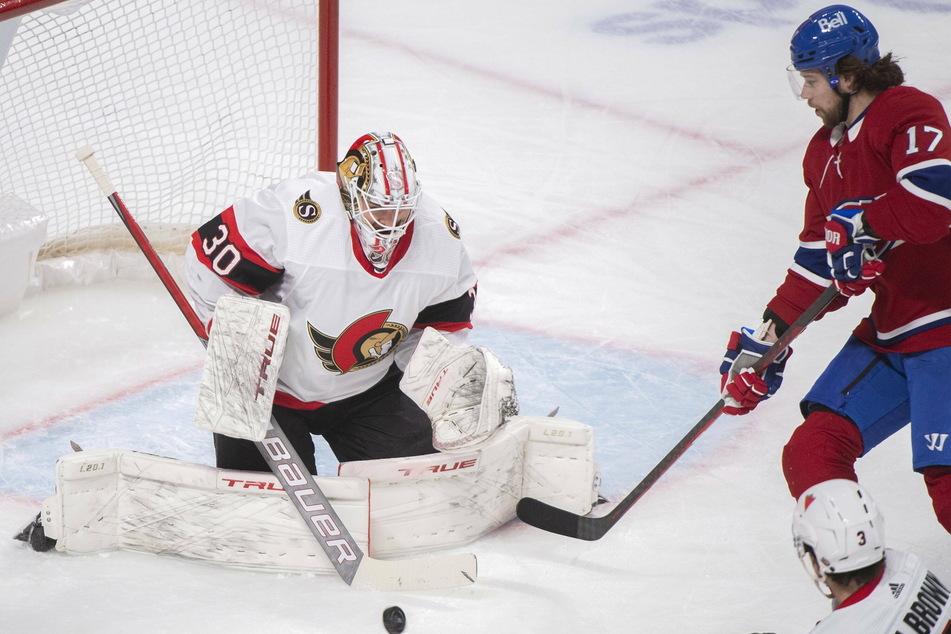 Ottawa Senators goaltender Matt Murray stops Montreal Canadiens right wing Josh Anderson during the Senators shutout victory