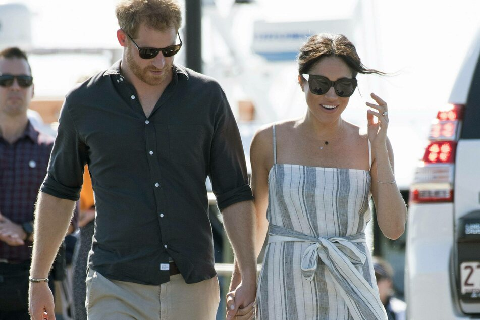 """Meghan and Harry flee paparazzi, but photographer calls them """"naive"""""""