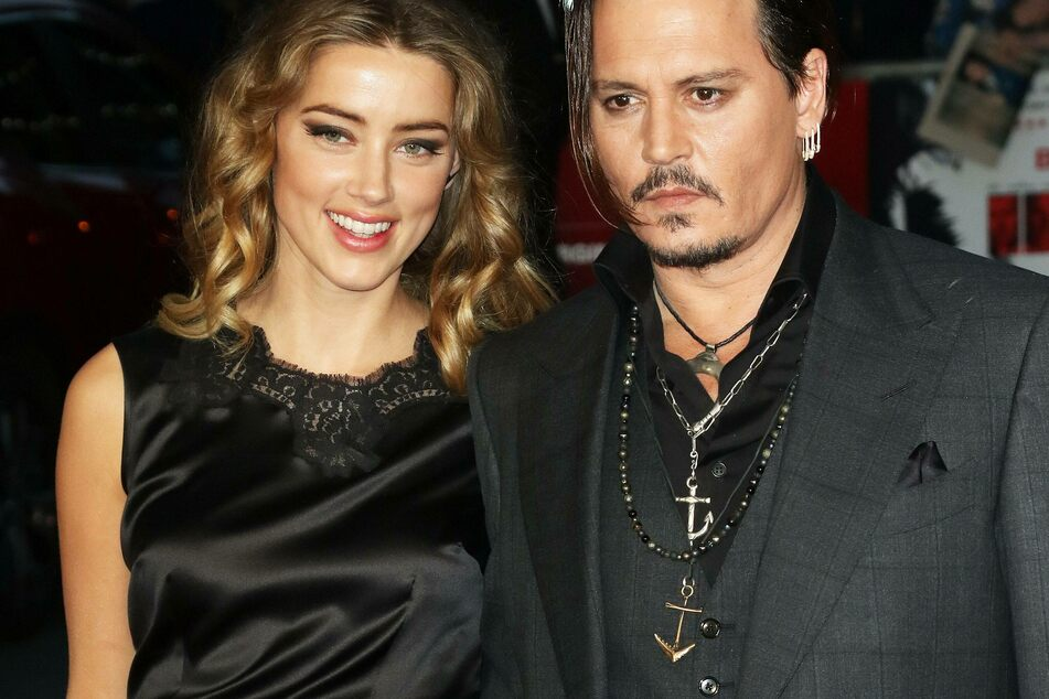 Amber Heard (l) and Johnny Depp (r) in happier days.
