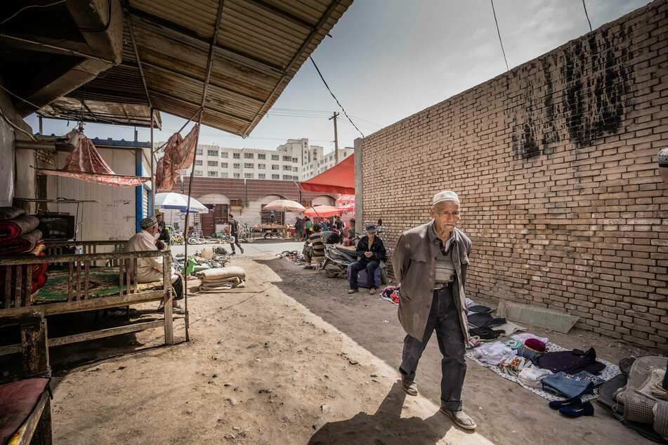 A Uighur man walks down an alleyway at the Kashgar bazaar. The Chinese government has issued a crackdown in the majority-Muslim province of Xinjiang and established a network of internment camps.
