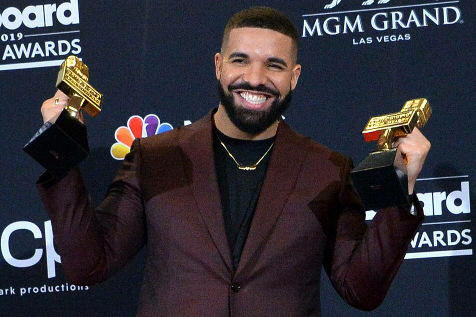 Canadian R&B star Drake poses with two of his twelve awards at the 2019 Billboard Music Awards.