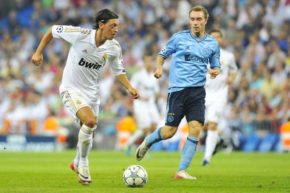 Real gegen Ajax: Christian Eriksen (r.) spielte mehrfach gegen den deutschen Weltmeister von 2014, Mesut Özil (l.).