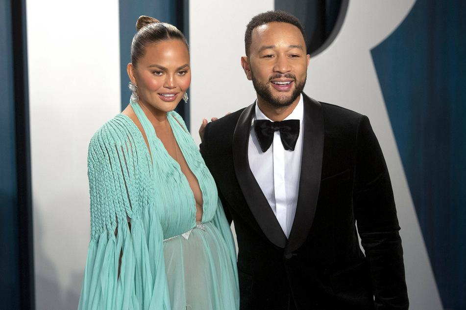 Chrissy Teigen and John Legend at the Vanity Fair Oscar Party 2020.