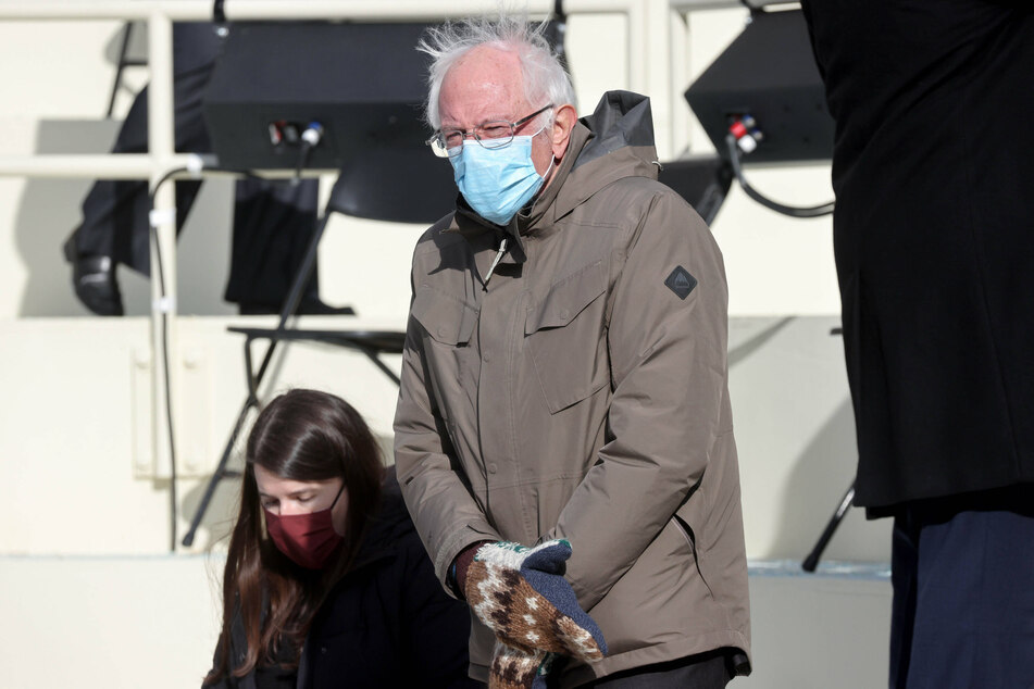 Bernie Sanders (r.) sported a brown coat, wool mittens, and a surgical face mask at Joe Biden's inauguration.