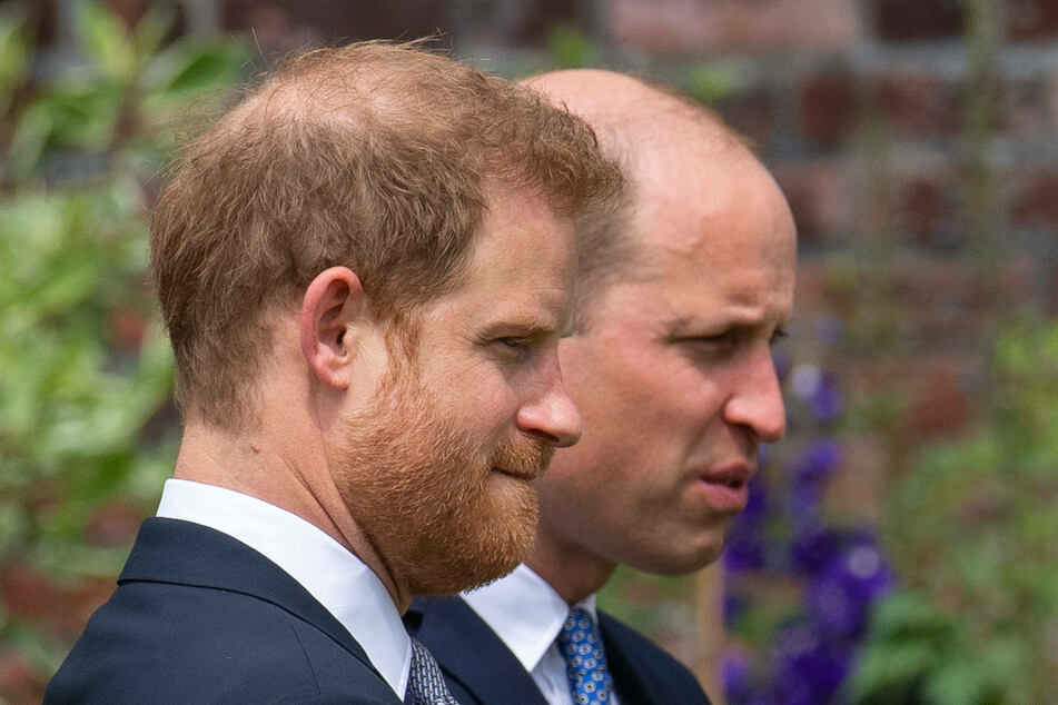 Prince William (l) and Prince Harry (r) both appear in a new documentary about their grandfather, but it's not clear if they filmed together or if they have reconciled.