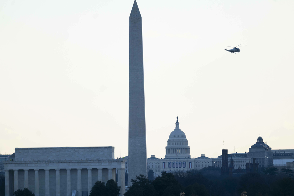 President Donald Trump does a final pass by the US Capitol after leaving the White House for the last time as president.