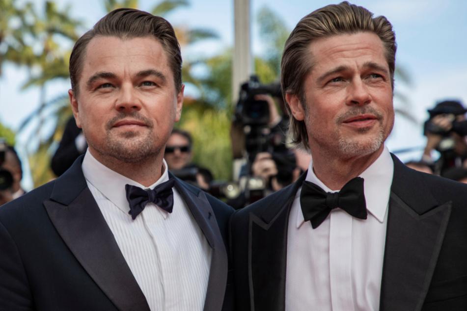 """Leonardo DiCaprio (l.) und Brad Pitt bei der Premiere des Films """"Once Upon a Time in Hollywood"""" auf dem 72. Internationalen Filmfestival in Cannes 2019."""