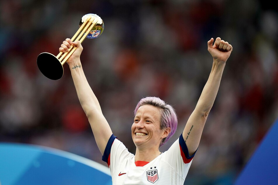 Meghan Rapinoe celebrates with the 2019 FIFA Women's World Cup trophy.