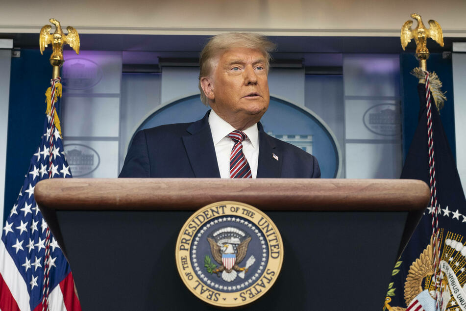 President Donald Trump gives a press briefing from the White House on Thursday evening.