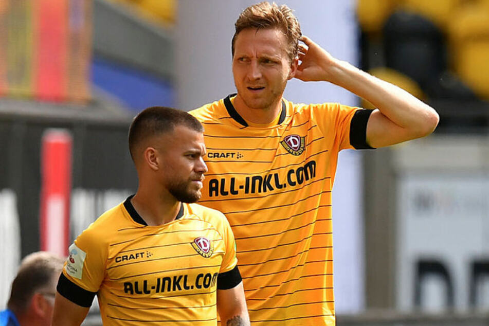Sascha Horvath (23, l.) und Marco Hartmann (32) stiegen mit Dynamo Dresden aus der 2. Bundesliga ab.