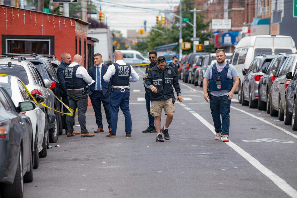 NYPD officers investigate the scene of the crime.