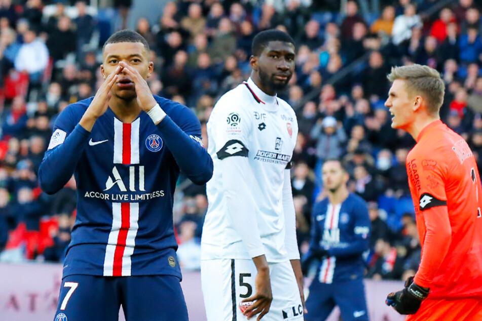 Ob Kylian Mbappé (l.) und PSG zum Meister gekürt werden, steht noch nicht fest. (Archiv- und Symbolbild)