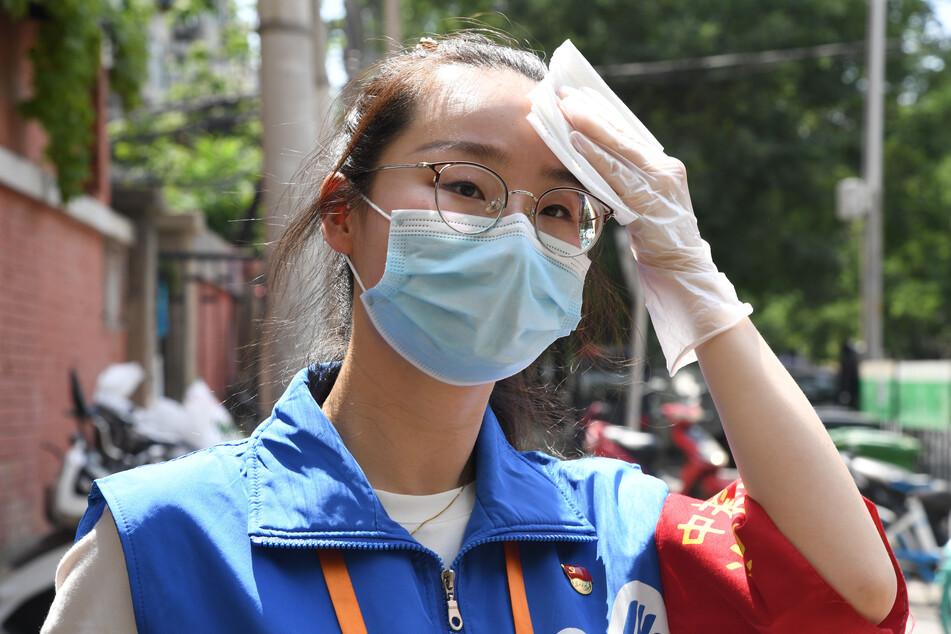 Peking hat als Reaktion auf die neuen COVID-19-Fälle die Krankheitsprävention und -kontrolle auf Gemeindeebene verstärkt.