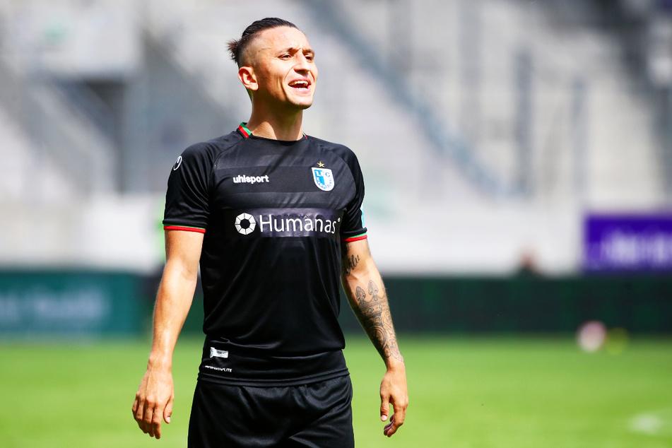 Baris Atik (26) wirft Dennis Erdmann (30) vor, ihn und andere Magdeburger Spieler rassistisch beleidigt zu haben.
