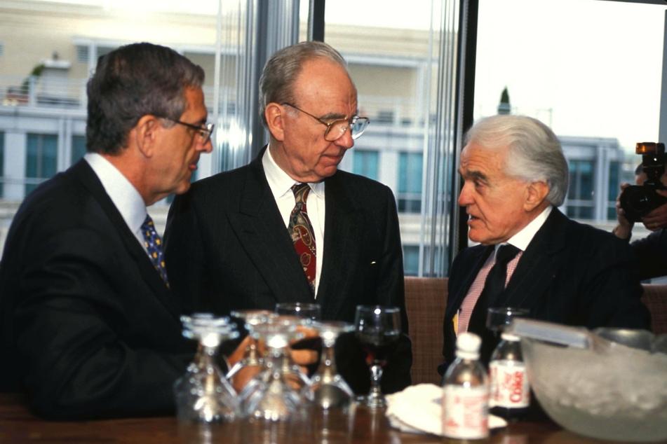 Howard Rubenstein (l.) with media mogul Rupert Murdoch (c.) and political advisor Jack Valenti in 1996.