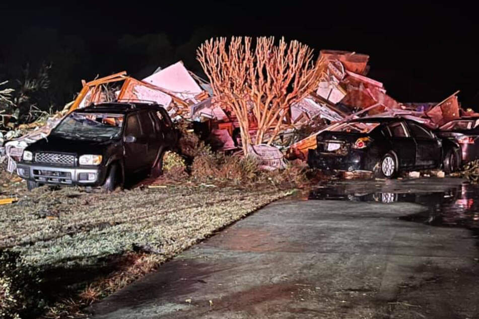 The devastating tornado snapped trees, hit cars, and destroyed houses along its path.