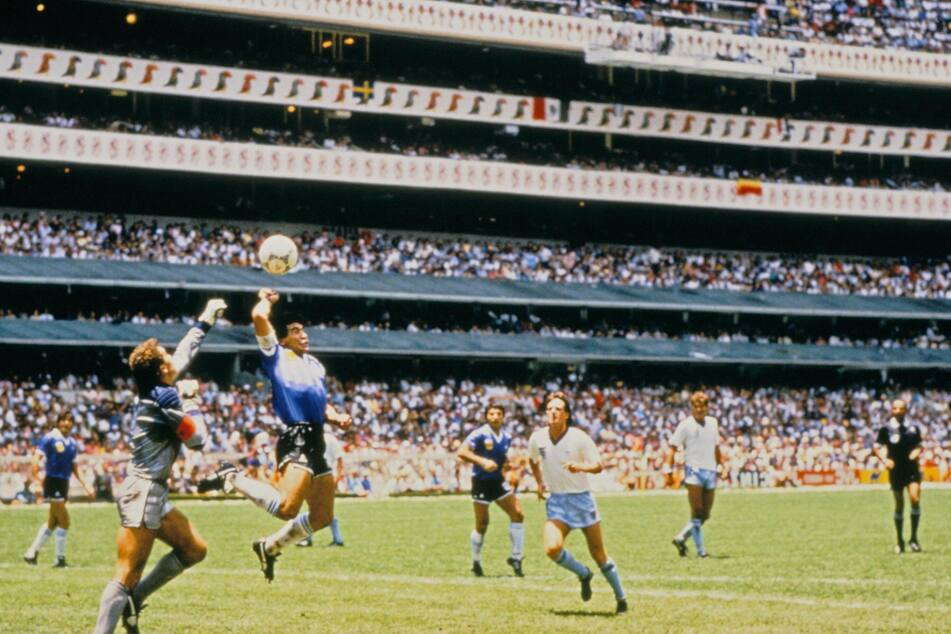 "Maradona scoring his infamous ""Hand of God"" goal against England."