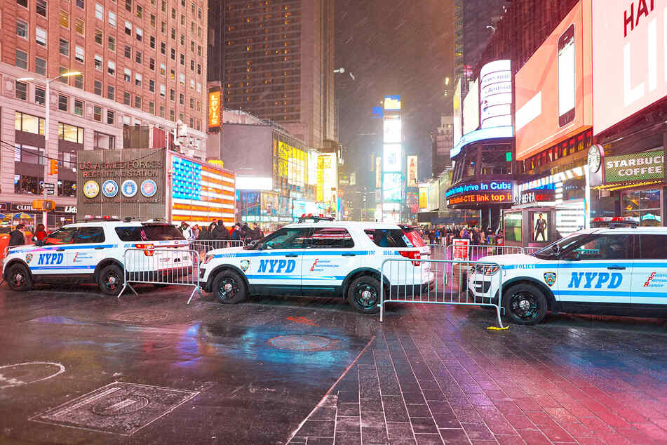 Numerous patrol cars secure Times Square in New York (stock image).