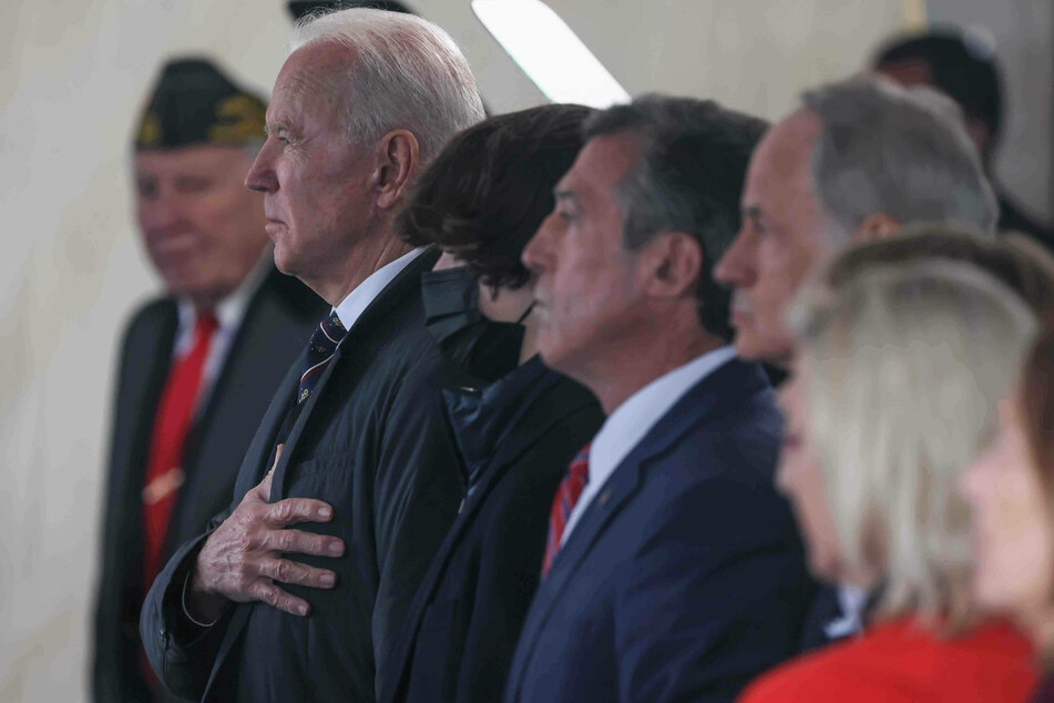 Joe Biden places his hand over his heart for the national anthem during the Memorial Day ceremony at Veterans Memorial Park in New Castle, Delaware.