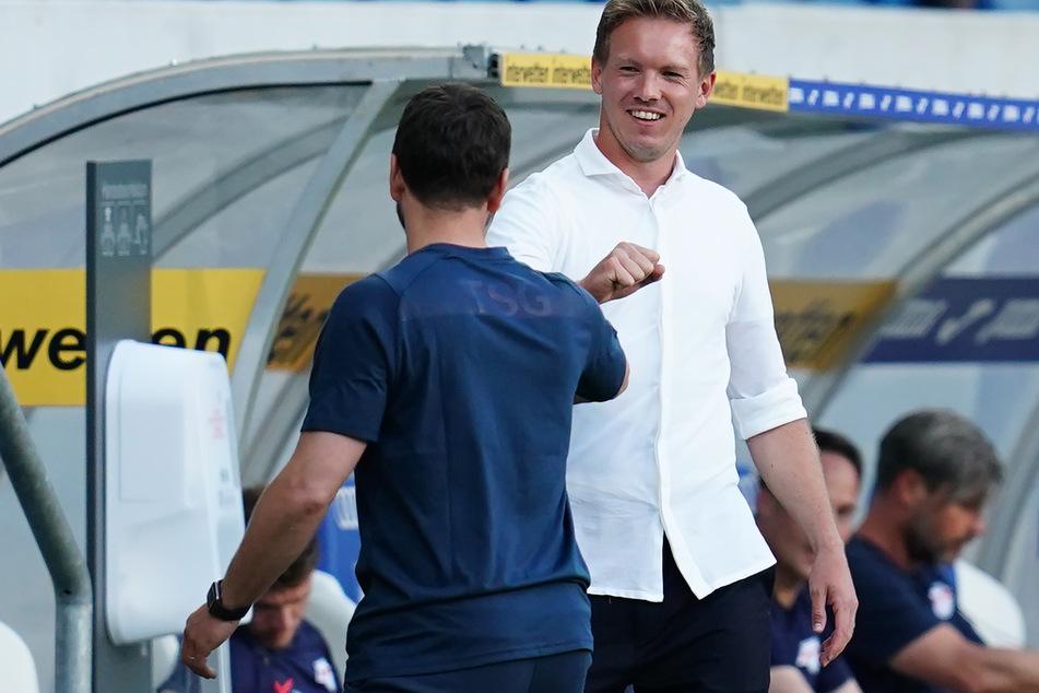 RB-Trainer Julian Nagelsmann (r.) kehrte am Freitag erstmals zu Ex-Verein Hoffenheim (hier der Begrüßung mit Interimscoach Matthias Kaltenbach) zurück.