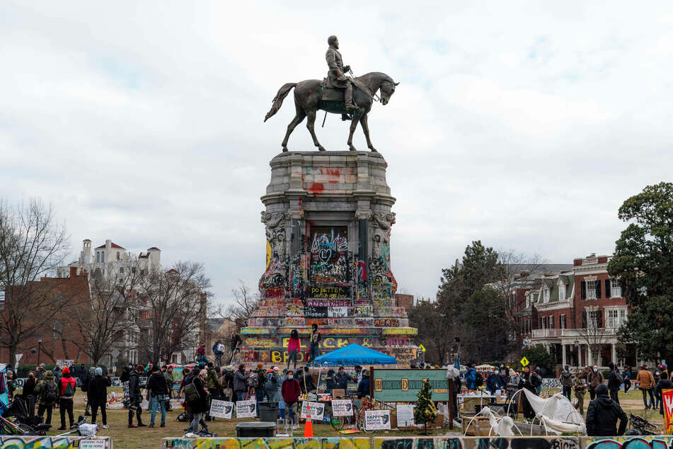 On MLK Day, a crowd gathered around a statue of Confederate General Robert E. Lee, which has been painted, decorated, and reclaimed by Black Lives Matter protestors.