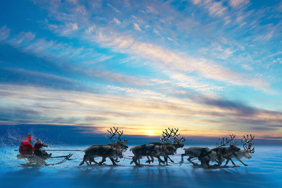 Santa Claus and his reindeer are on their way to hand out presents to well-behaved children (stock image).