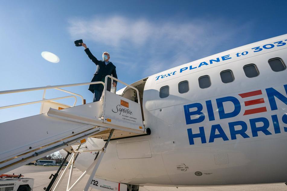 Democratic candidate Joe Biden preparing to board a flight on his campaign tour.