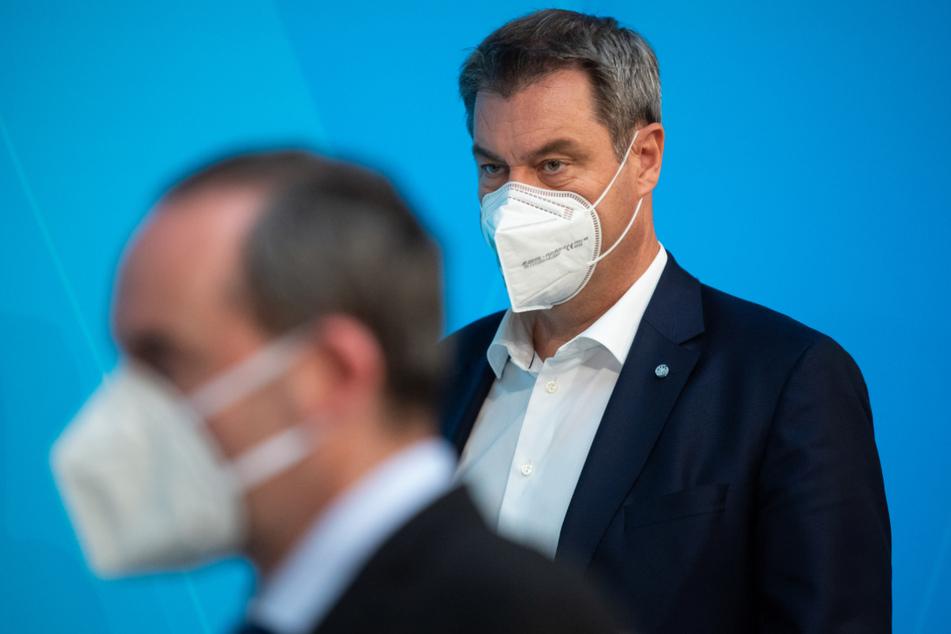 Markus Söder (54, CSU, r), Ministerpräsident von Bayern, und Hubert Aiwanger (Freie Wähler), Wirtschaftsminister von Bayern, stehen angesichts der Maskenaffäre unter Druck.