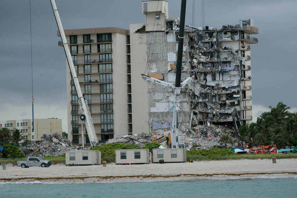 Surfside building collapse: Death toll hits 11 as search continues