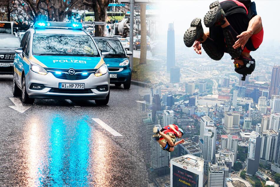 Männer springen von Autobahnbrücke und öffnen plötzlich Fallschirm