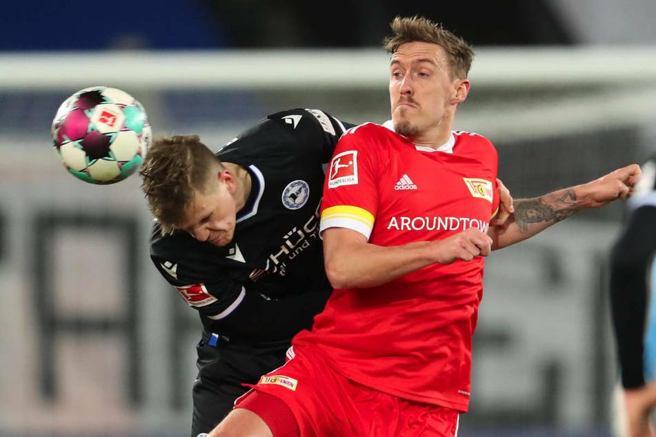 Max Kruse (r.) im Zweikampf mit Bielefelds Joakim Nilsson (27). Unions Star-Stürmer weiß sich auf und abseits des grünen Rasens zur Wehr zu setzen.